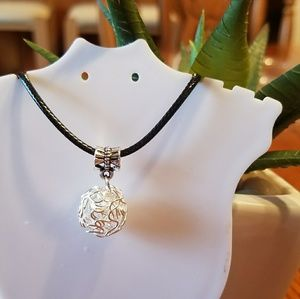 Knotted Tibetan silver black cord necklace